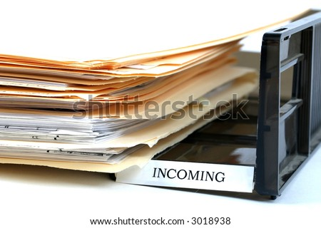 Close up of office inbasket - stock photo