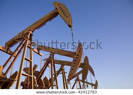 close-up of oil pump jacks. - stock photo