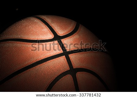 Close up of old basketball on dark background - stock photo