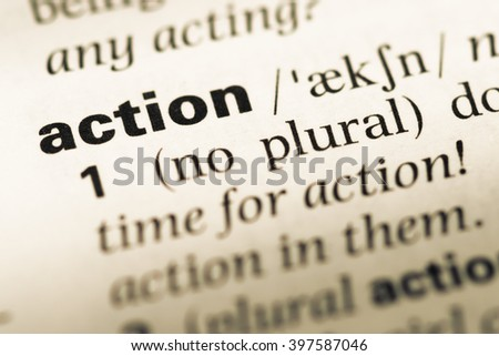 Close up of old English dictionary page with word action - stock photo