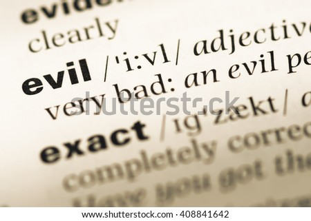 Close up of old English dictionary page with word evil - stock photo