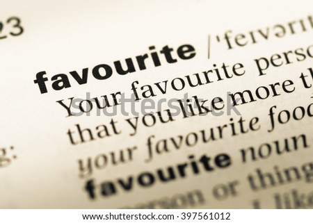 Close up of old English dictionary page with word favourite - stock photo