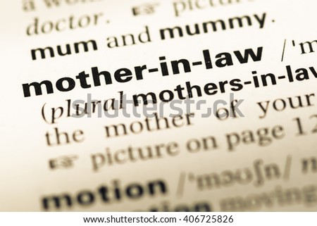 Close up of old English dictionary page with word mother in law - stock photo