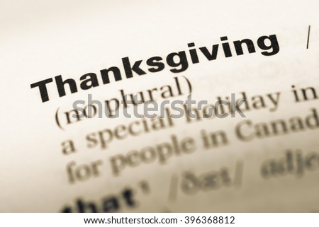 Close up of old English dictionary page with word thanksgiving