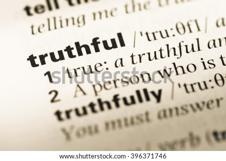 Close up of old English dictionary page with word truthful - stock photo