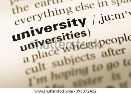 Close up of old English dictionary page with word university - stock photo
