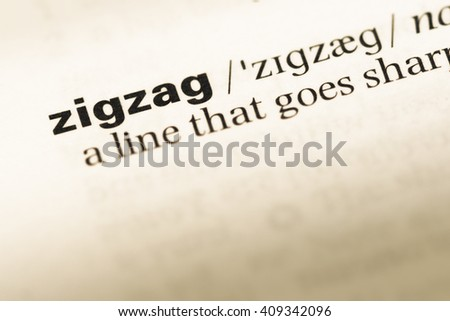 Close up of old English dictionary page with word zigzag