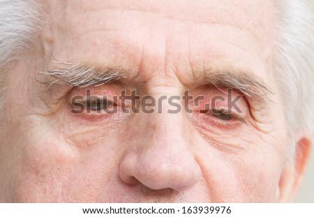 Close up of old man eyes - stock photo
