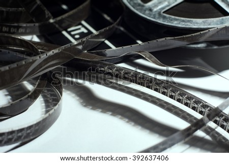 Close-up of old narrow films lying with a coil.
