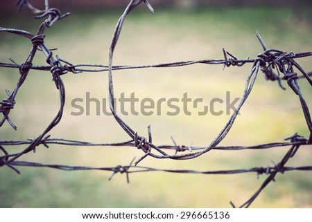 Close up of old rusty barbed wire. Vintage effect. - stock photo