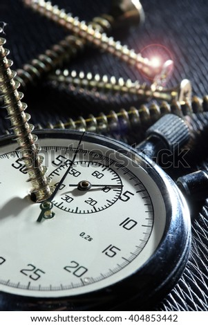 close-up of old stopwatch on a black background studio - stock photo