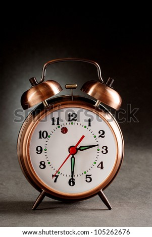 Close up of old style alarm clock - stock photo