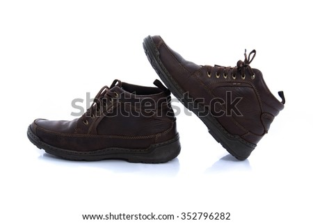 Close up of old vintage leather boot on white background isolated