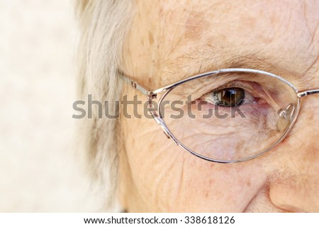 Close-up of old woman's eye - stock photo