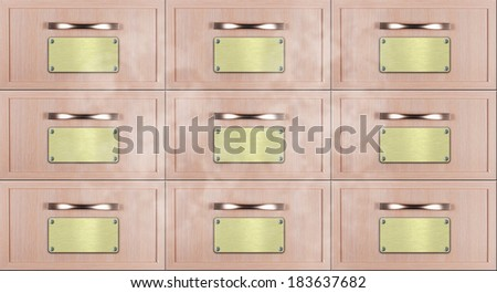 Close up of old wooden card catalogue with golden labels nailed by white metal screws - stock photo