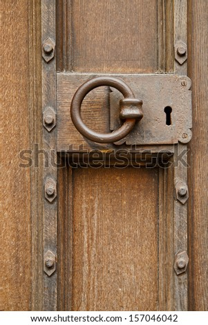 close up of old wooden door and lock - stock photo