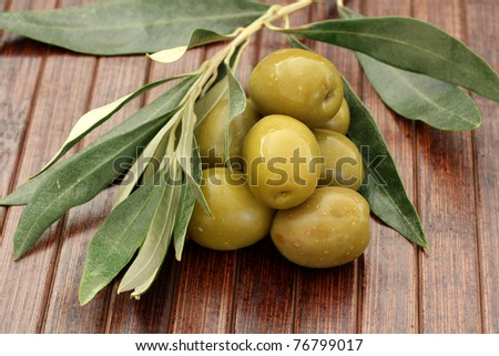 Close up of Olives on a wooden table - stock photo