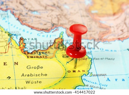 Close up of  Oman   map with red pin  - travel concept - stock photo