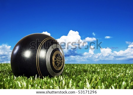Close up of one bowling ball on an open bowling field - stock photo