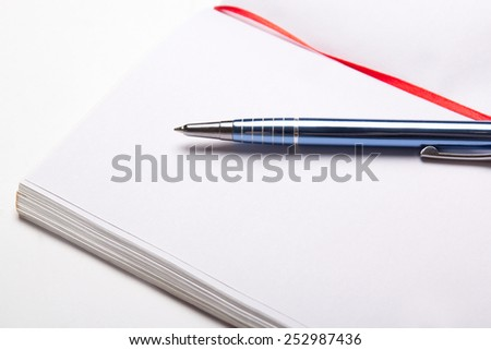 close up of open note book with copy space on pages with pen - stock photo