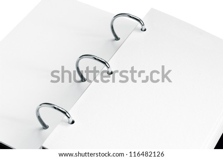 close up of open notebook with blank pages - stock photo