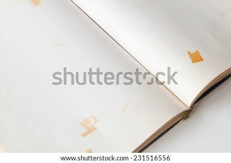 Close-up of open old book on white background - stock photo