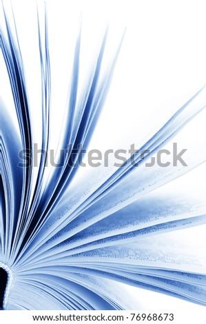Close-up of opened book on white background. Toned image. - stock photo