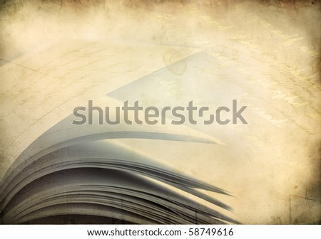 Close-up of opened book pages against vintage background - stock photo