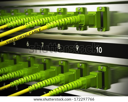 Close up of optical fiber optic patchcords inside a network infrastructure. Blur effect with focus on one cable.