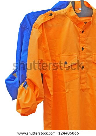 close up of orange and blue  full sleeve shirt arranged in a row
