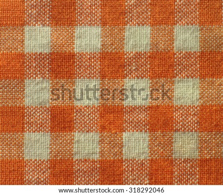 Close-up of orange-white checkered  canvas texture - fabric background - stock photo