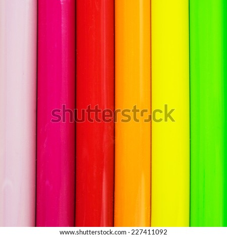 Close up of ordered children's rainbow modeling clay can be used for background