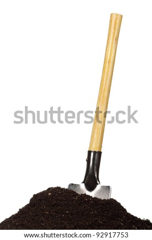 Close-up of organic soil and spade isolated on white background - stock photo