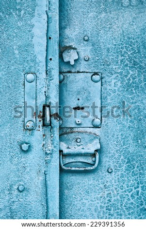 Close up of padlock and old metal hasp and staple on an vintage door - stock photo