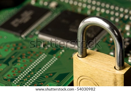 Close up of padlock on computer circuit board. Concept of network security.
