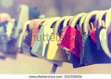 Close-up of padlocks on bridge railing