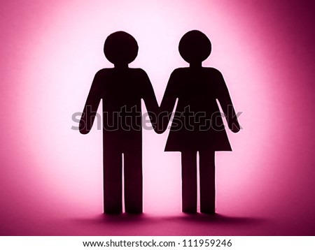 Close up of paper man and woman. Love concept. - stock photo
