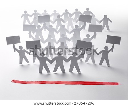 close up of  paper people rally on white background - stock photo