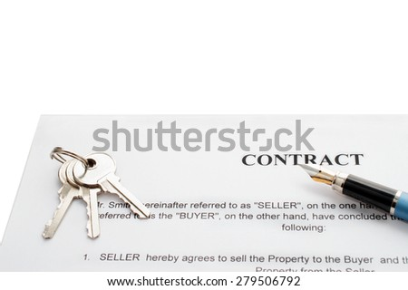 Close-up of pen on contract and keys - stock photo
