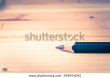 Close up of pencil on wooden background. Macro with extremely shallow depth of field. Vintage tone. - stock photo