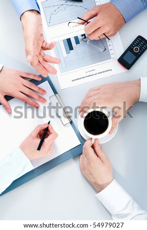 Close-up of people hands during business conversation - stock photo