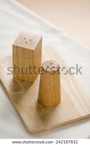 Close up of pepper box on wooden table - stock photo