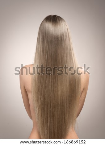 Close-up of perfect healthy long blond hair.