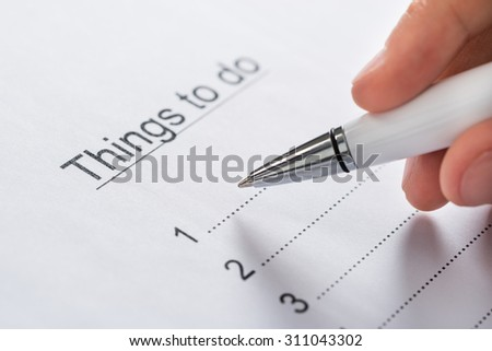 Close-up Of Person Hands Planning List Of Work To Do - stock photo