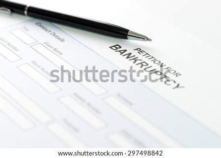 Close up of petition for bankruptcy form and pen