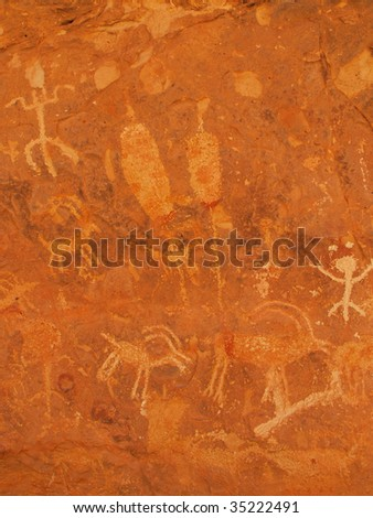Close up of petroglyphs carved onto cave wall by prehistoric Native Americans in Snake Gulch, Arizona, USA. - stock photo
