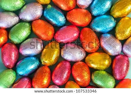 Close-up of pile of colorful chocolate Easter Eggs. - stock photo