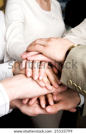 Close-up of pile of partners? hands over each other - stock photo