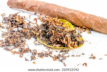 close-up of pile of tobacco on white background. - stock photo
