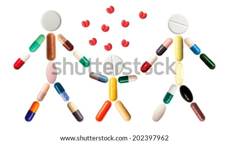 Close-up of pills and capsules representing happy family isolated on white background - stock photo